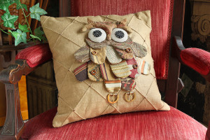 Owl pillow from fabric scraps with buckles