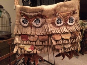 Two owls perched on messenger bag